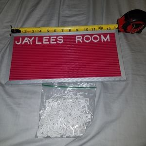 Pink message board with bag of letters